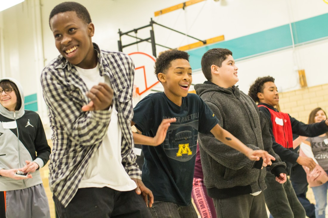 Students dancing on retreat — silliness and laughter abound