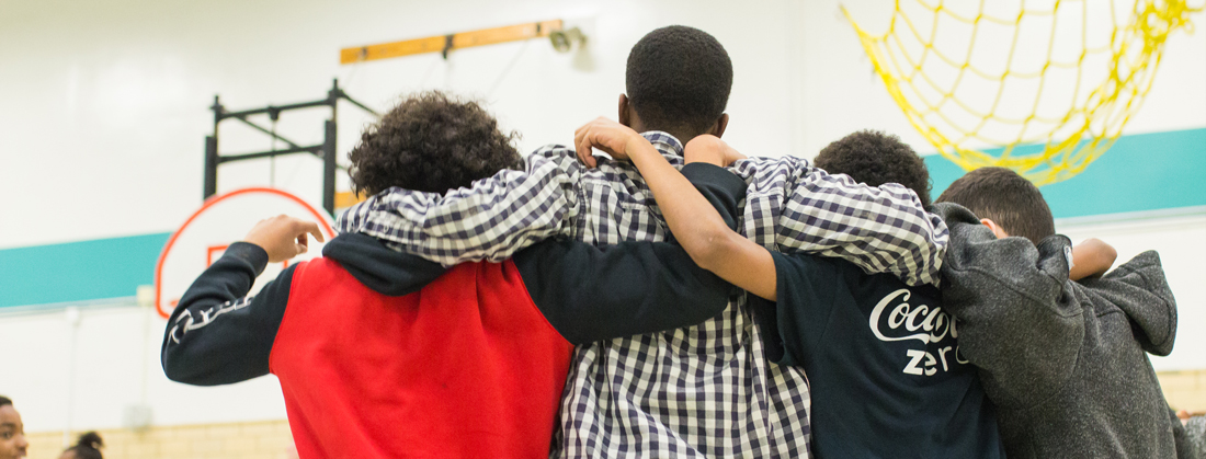 Students standing with arms around each others' shoulders at a Courage Retreat