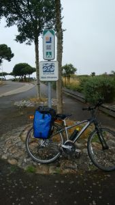 Julia's bike leaning up against a french road sign