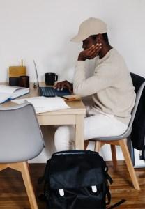 man sitting at desk on a grey chair