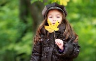 cute-girl-with-fall-leaf-in-wi