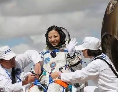 Why are female astronauts strictly prohibited from giving birth?
