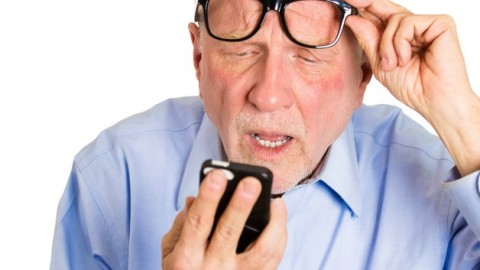 old_man_looking_at_smartphone