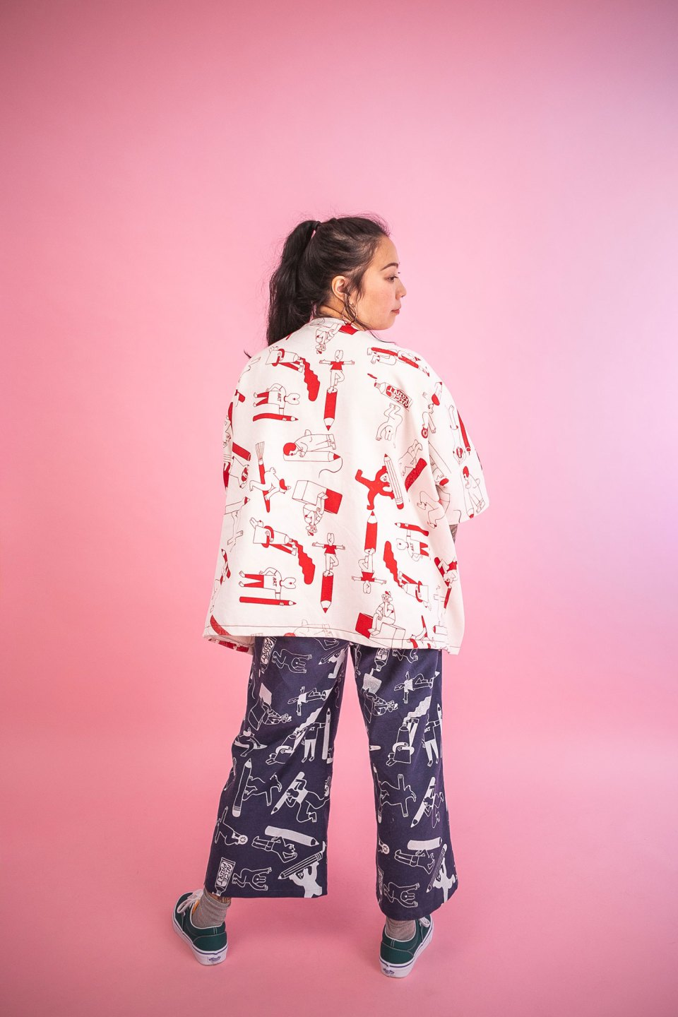Mix n match YUK FUN Artist Suit: Becky wears a red on natural print jacket with our denim print trousers