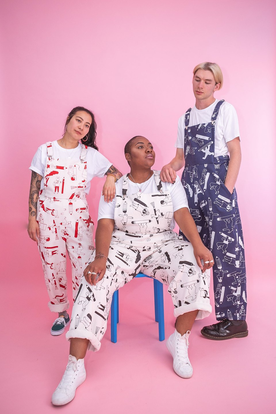 3 models wearing all over print dungarees made by YUK FUN X The Emperor's Old Clothes