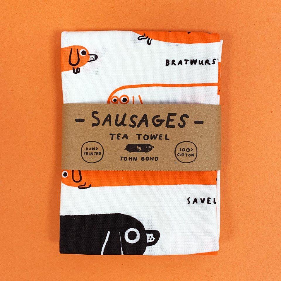 Sausage dog tea towel by John Bond