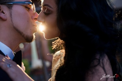 Natalia and Alfredo take romantic pictures at Julieanne's Patio Cafe.