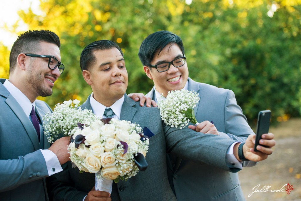 Stan and Anel's groomsmen and bridesmaids gets wedding pictures taken of them.
