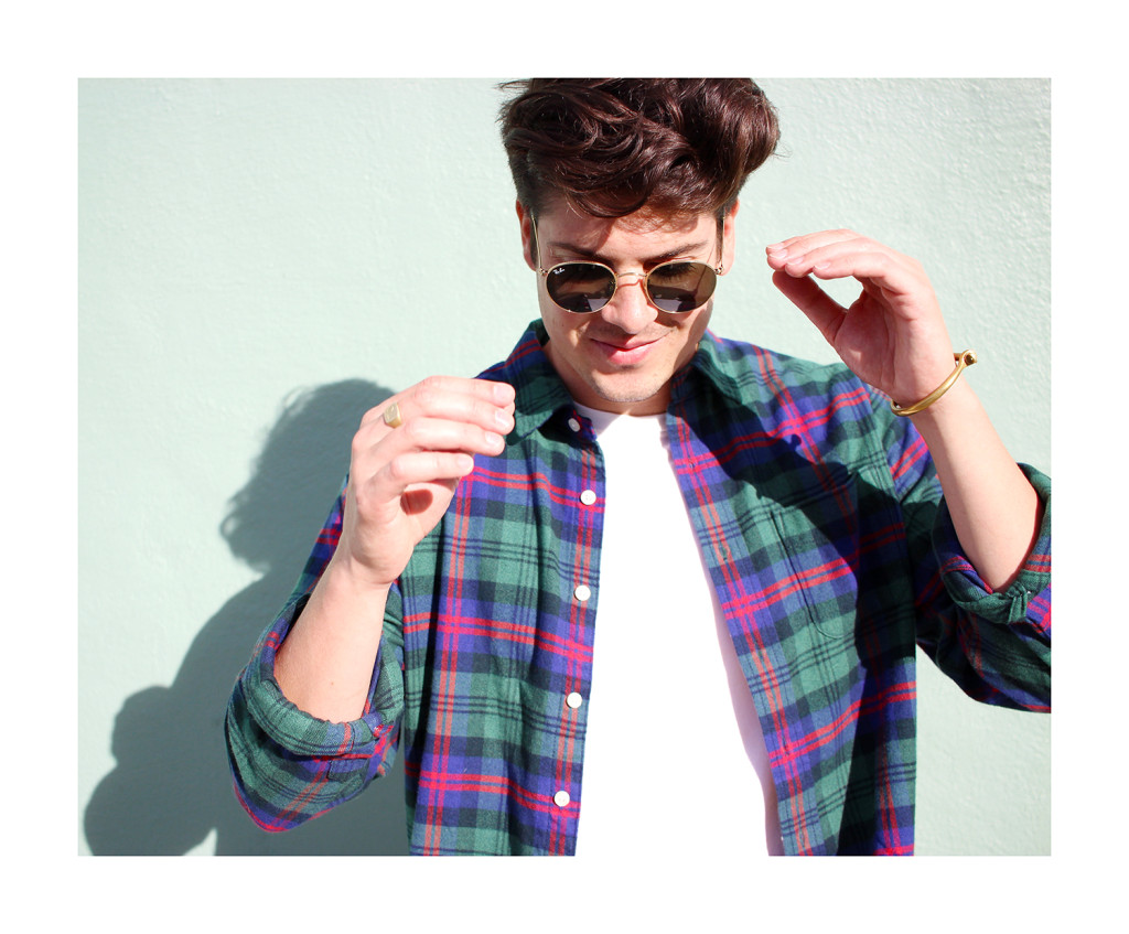 Brock, of Yummertime, in round Ray-Ban sunglasses and Miansai cuff