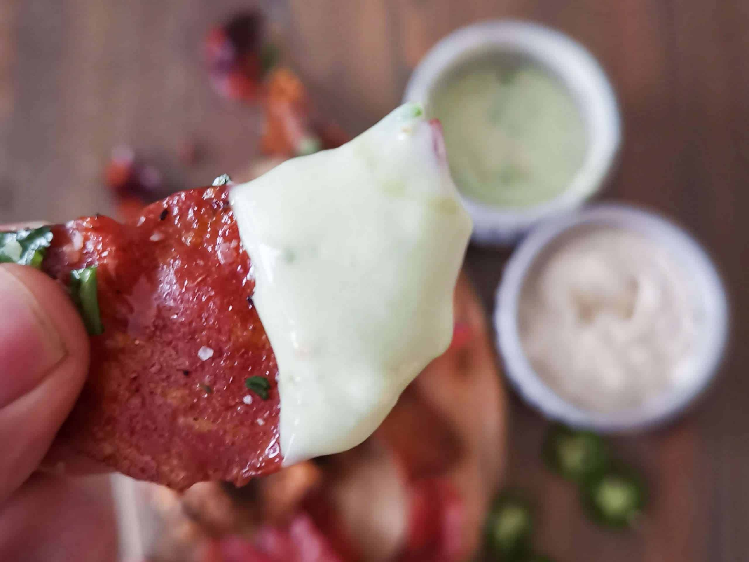 Keto friendly chips made from baked salami with dip
