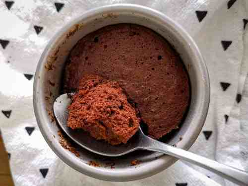 Keto mug brownie from above with a spoon