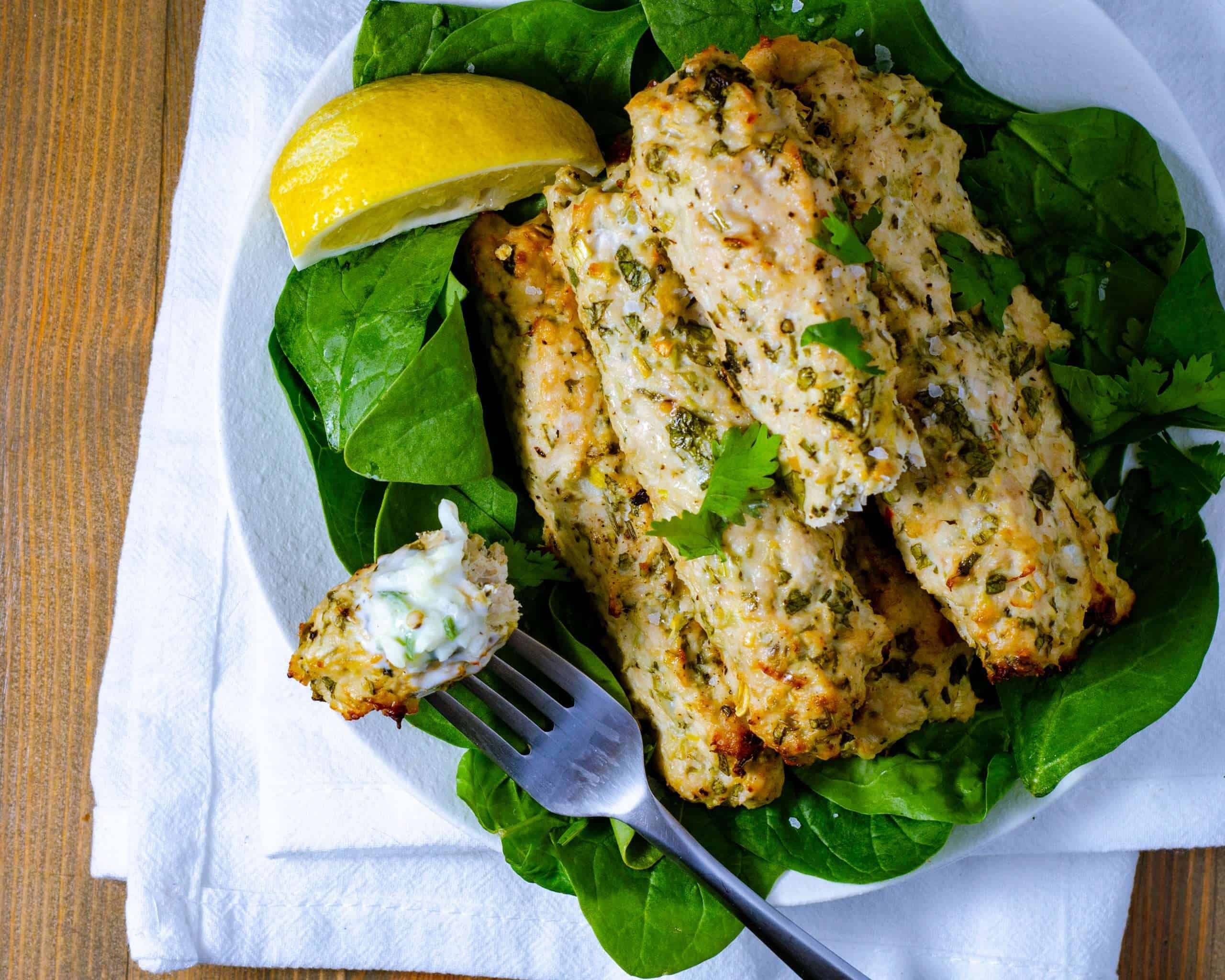 Low Carb Chicken kebab on a plate and for with lemon and raita