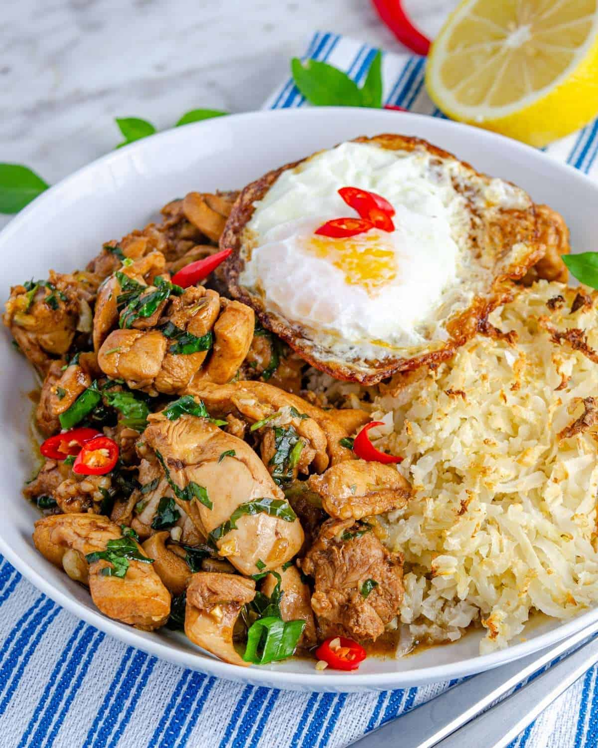 A bowlful os low carb Thai basil chicken with sides