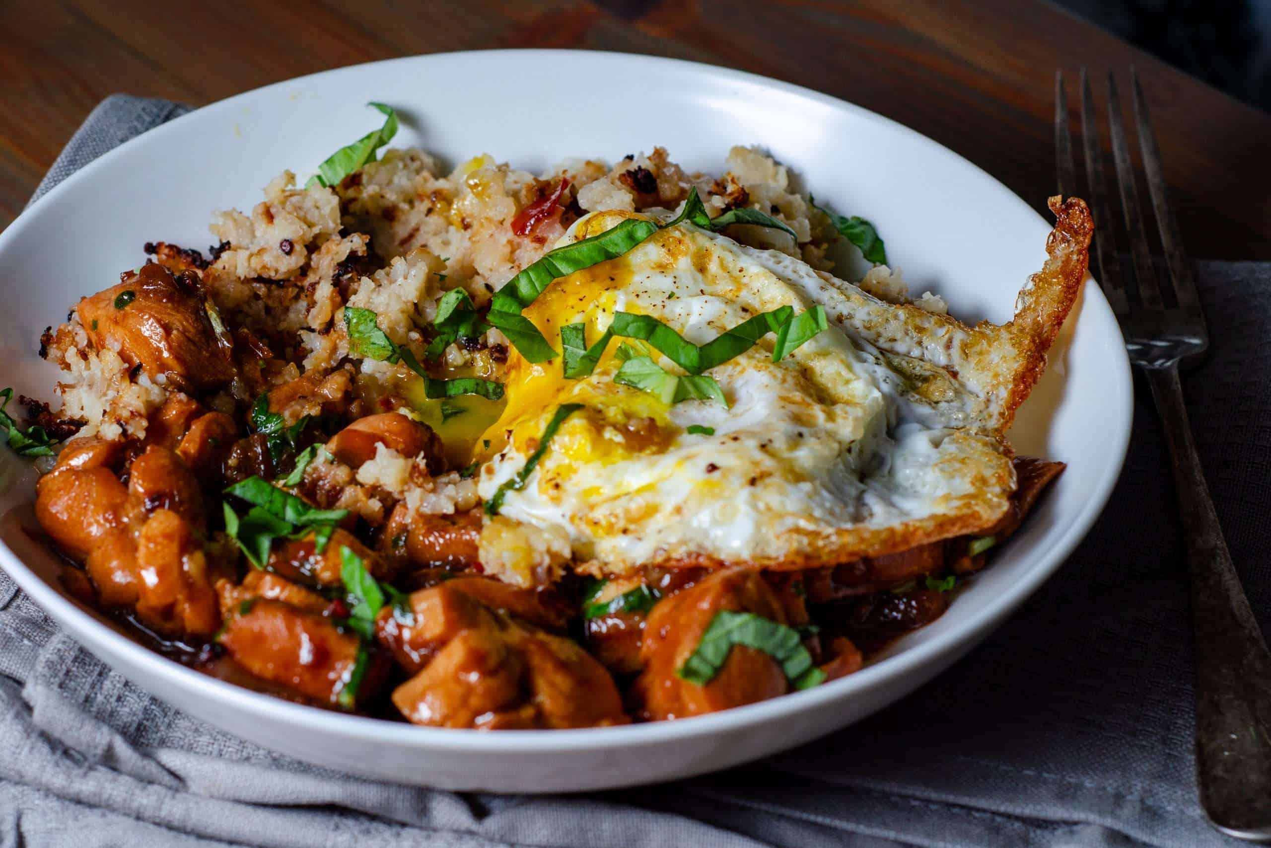 Thai Basile Chicken topped with a crispy fried egg