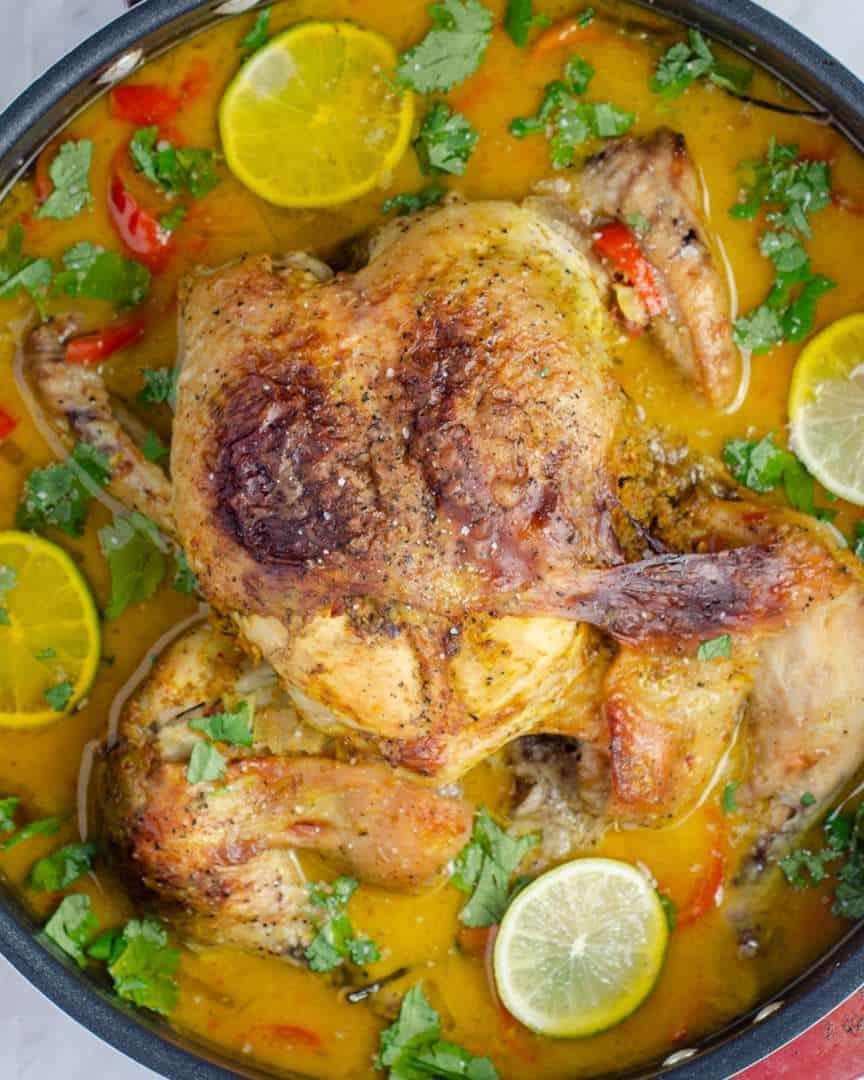 Keto Thai Coconut Milk Braised Chicken in a pan with gravy and garnish