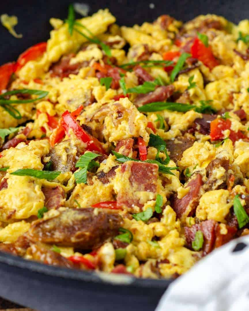 Protein keto scrambled eggs garnished in a frying pan