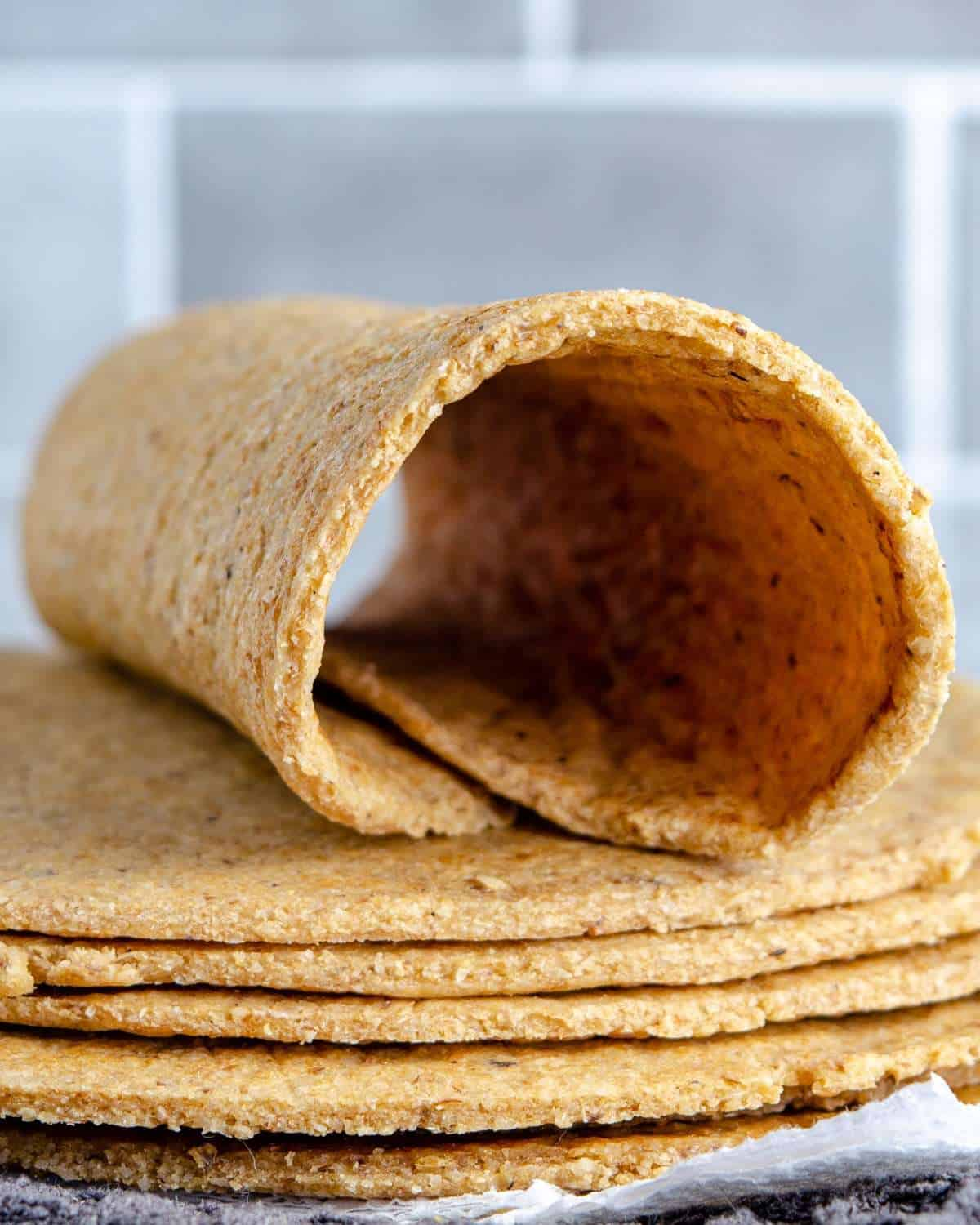 A low carb oat fiber tortilla wrapped on a stack