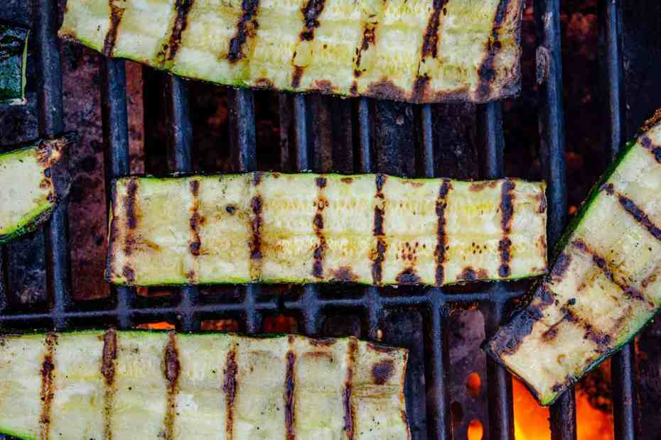 Slices of zucchini on a BBQ grill