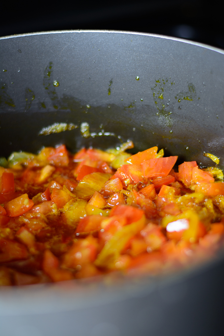 Tomatoes added into the stew