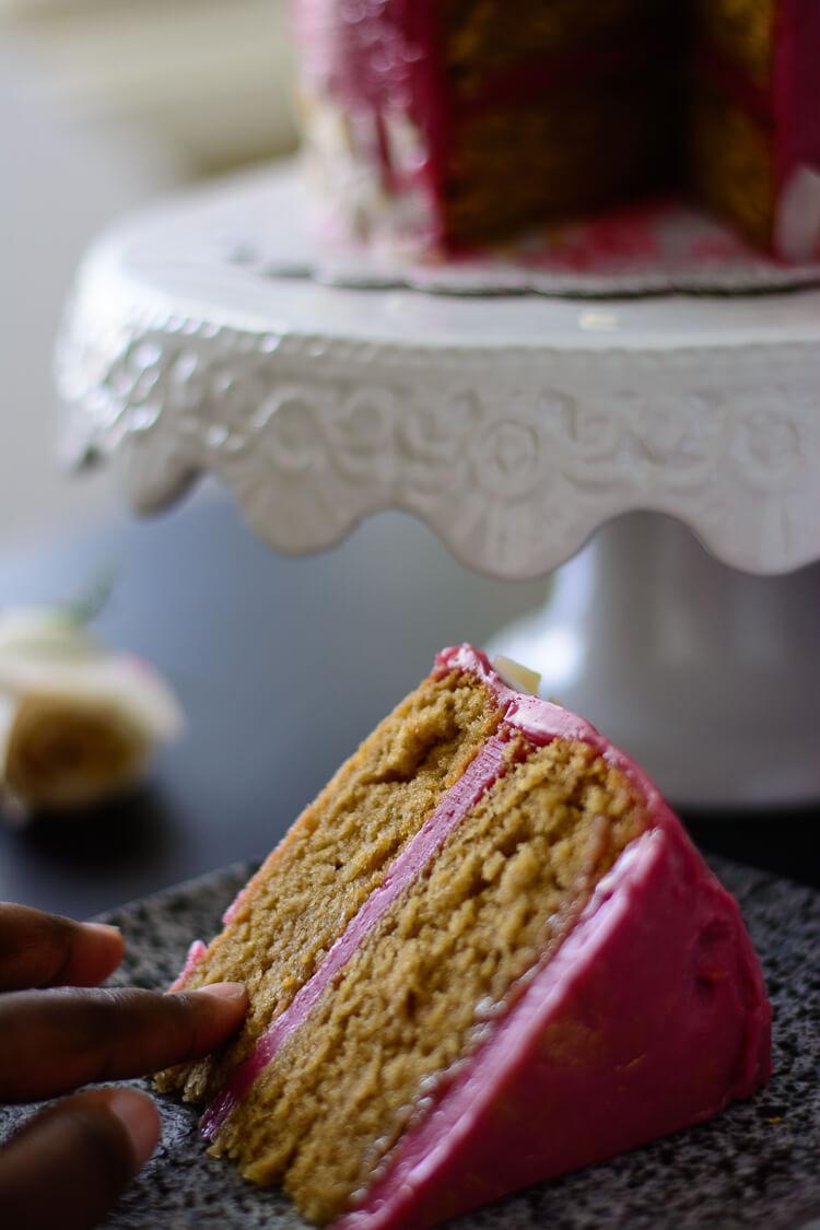 finger touching a moist slice of earl grey sponge cake