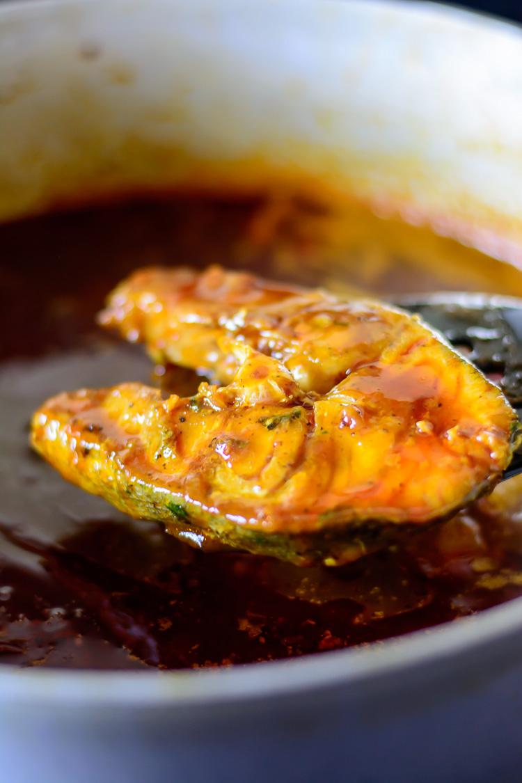 thieboudienne: Adding fish to tomato sauce