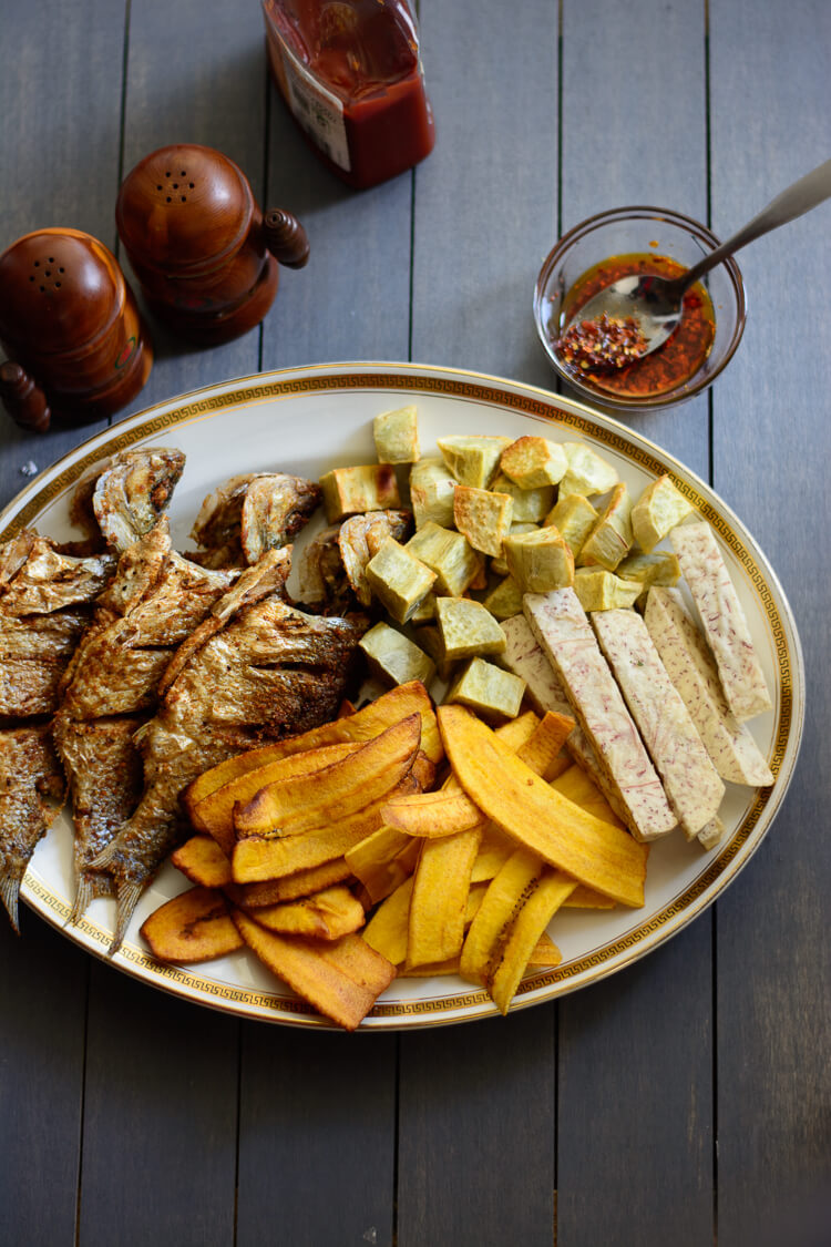 Tropical Chips and Fish - fried perch with fried sweet potato cubes, fried taro root, and some plantain chips, ketchup and pepper mix on the side
