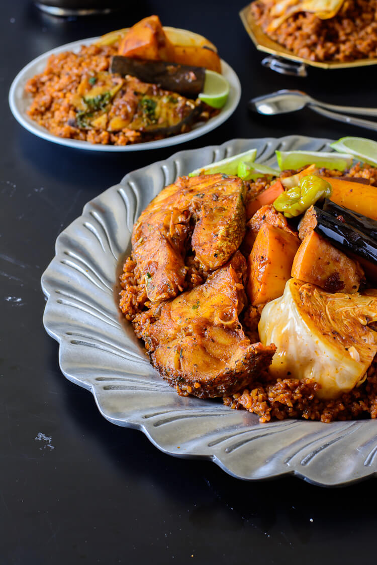 Thieboudienne (Senegalese Jollof Rice and Fish) served on plate on table