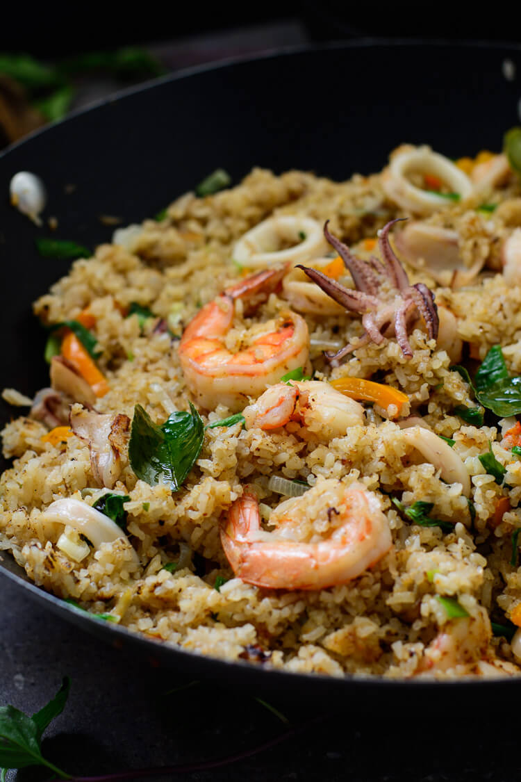 close up shot of fixed seafood coconut fried rice in a wok