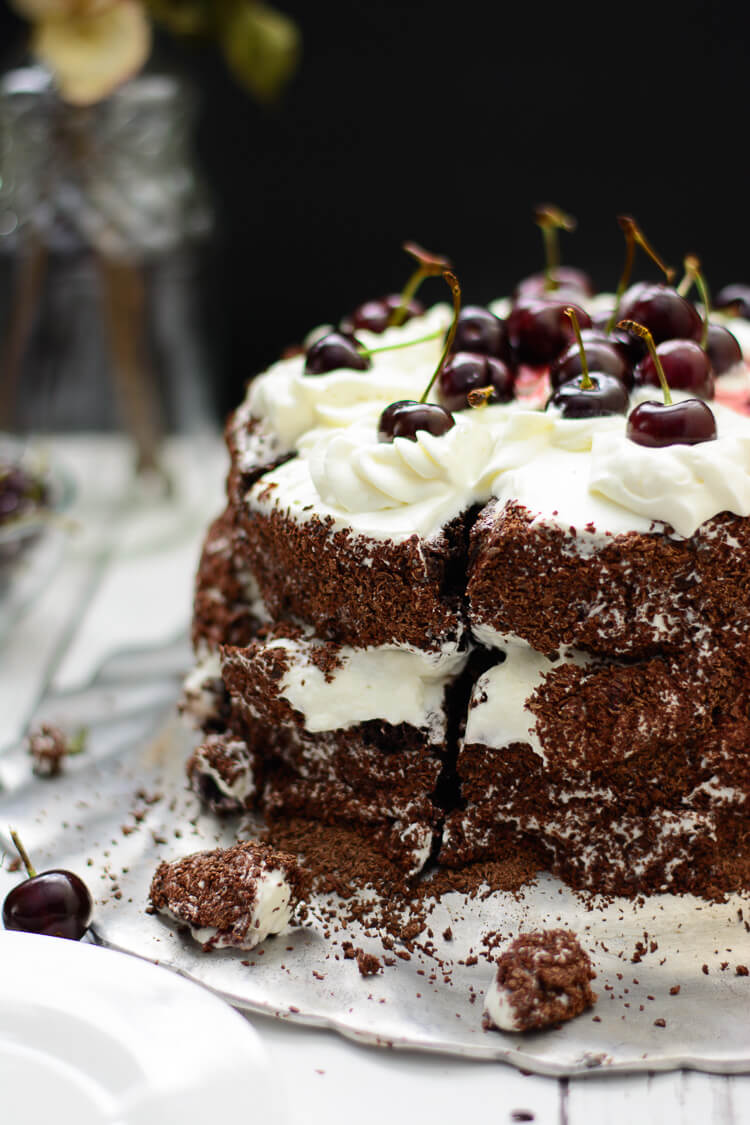 taking a slice of black forest cake with a knife