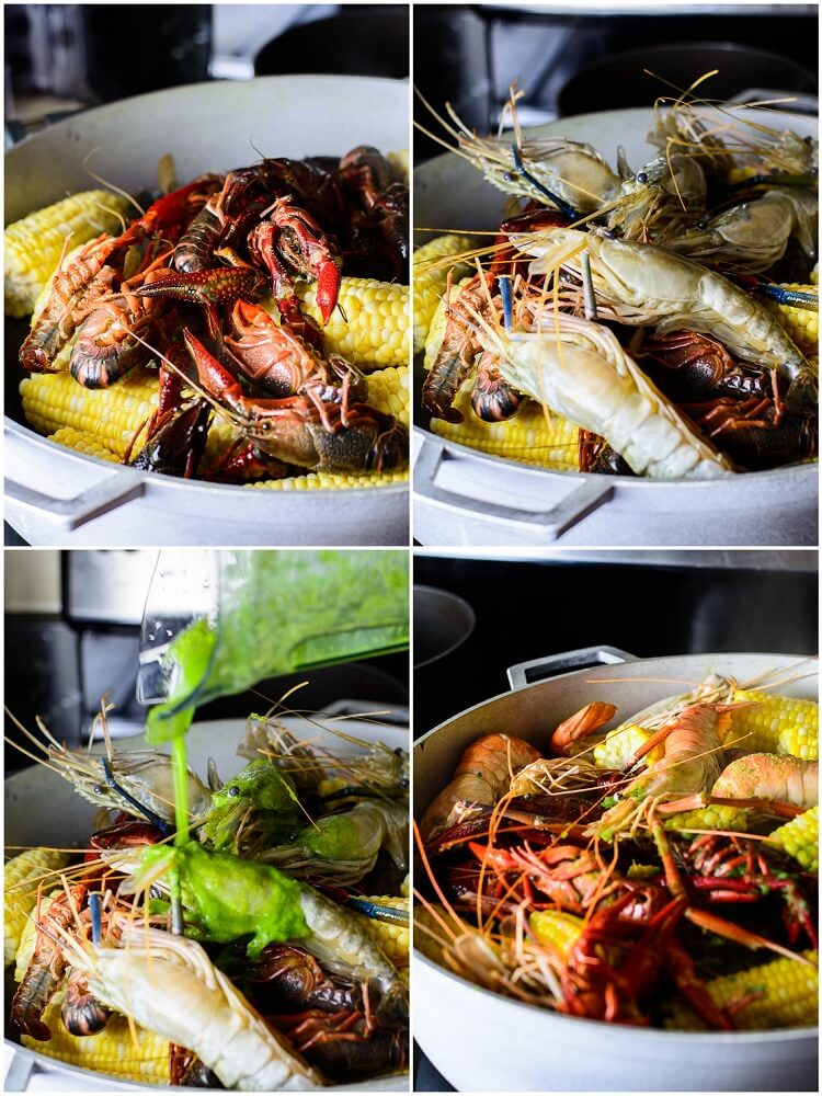 Best Summer Seafood Boil with Homemade Seasoning - Prawns and Crawfish added to crabs and corn in pot