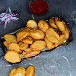 Nigerian Akara Recipe (Accara/Acaraje): Black Eyed Pea Fritters - Akara with spicy dipping sauce top shot