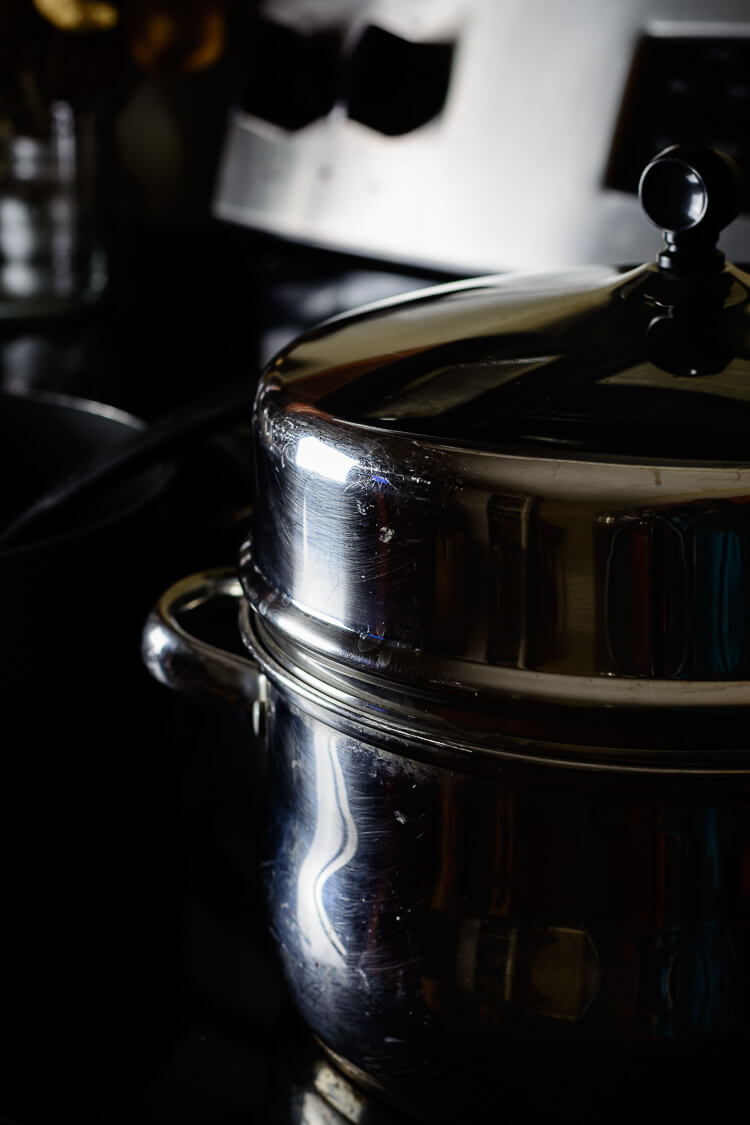 Moin-Moin/Moi Moi Recipe: Steamed Black Eyed Peas Pudding - covered pot on the cooker
