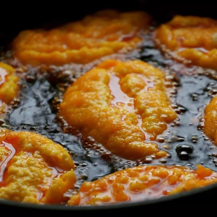 West African bean fritters frying in hot oil
