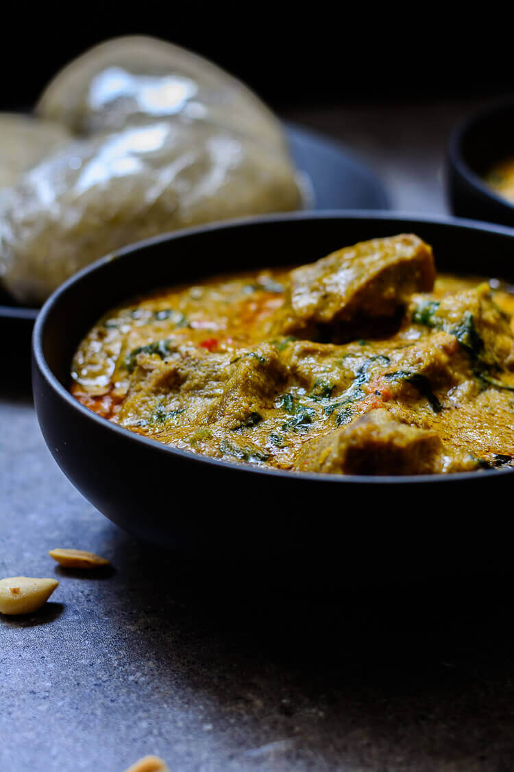 Groundnut Soup (Spicy Nigerian Peanut Stew) - close up shot of groundnut soup and eba