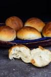 Ghana Sugar Bread Rolls - 5 bread rolls in picnic basket with one broken open