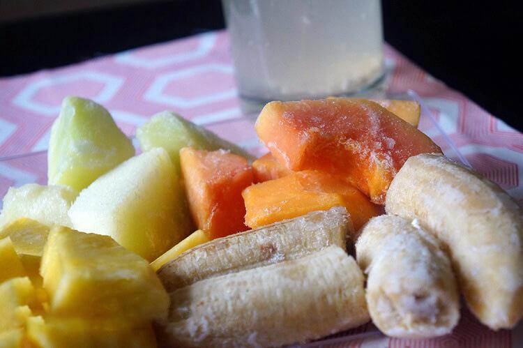 Island Green Smoothie Ingredients: Sliced Bananas, pineapples, papaya and honeydew melon