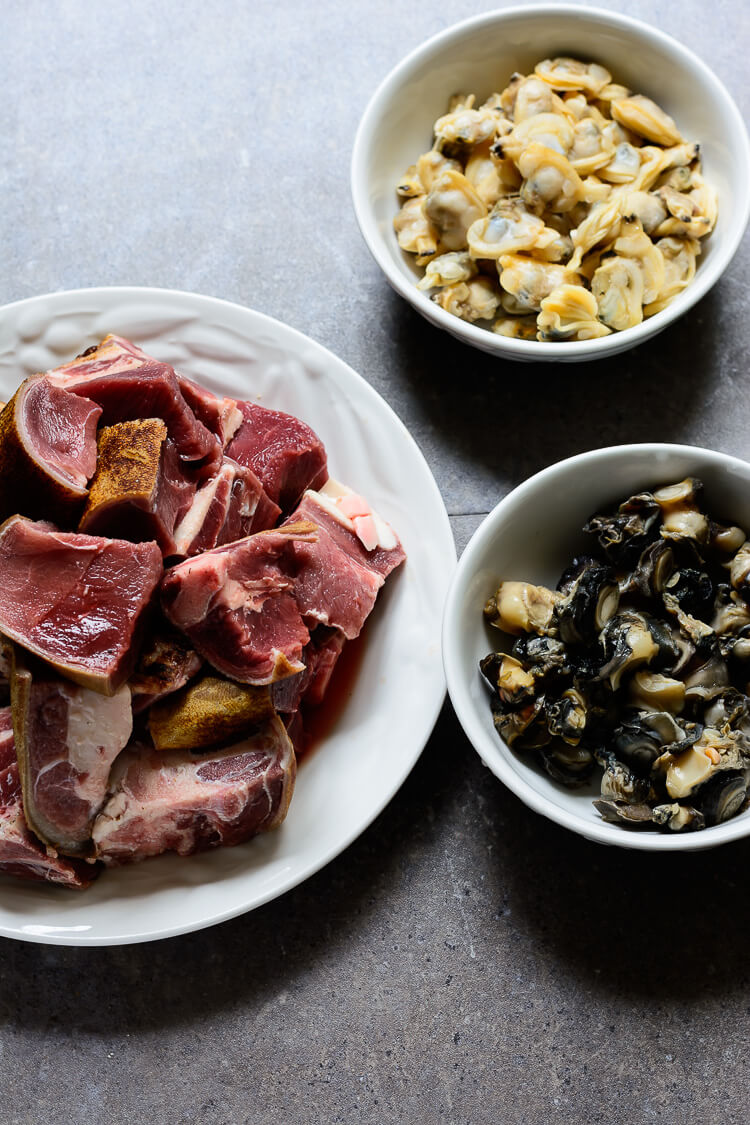 Bowls of beef, snails and clam meats