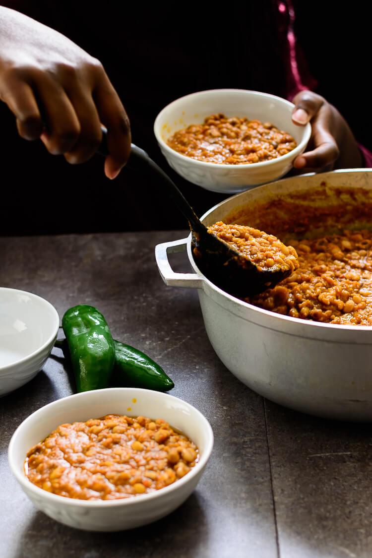 Nigerian Beans Porridge (Ewa Oloyin) - Dishing out bowls of the delicious bean porridge