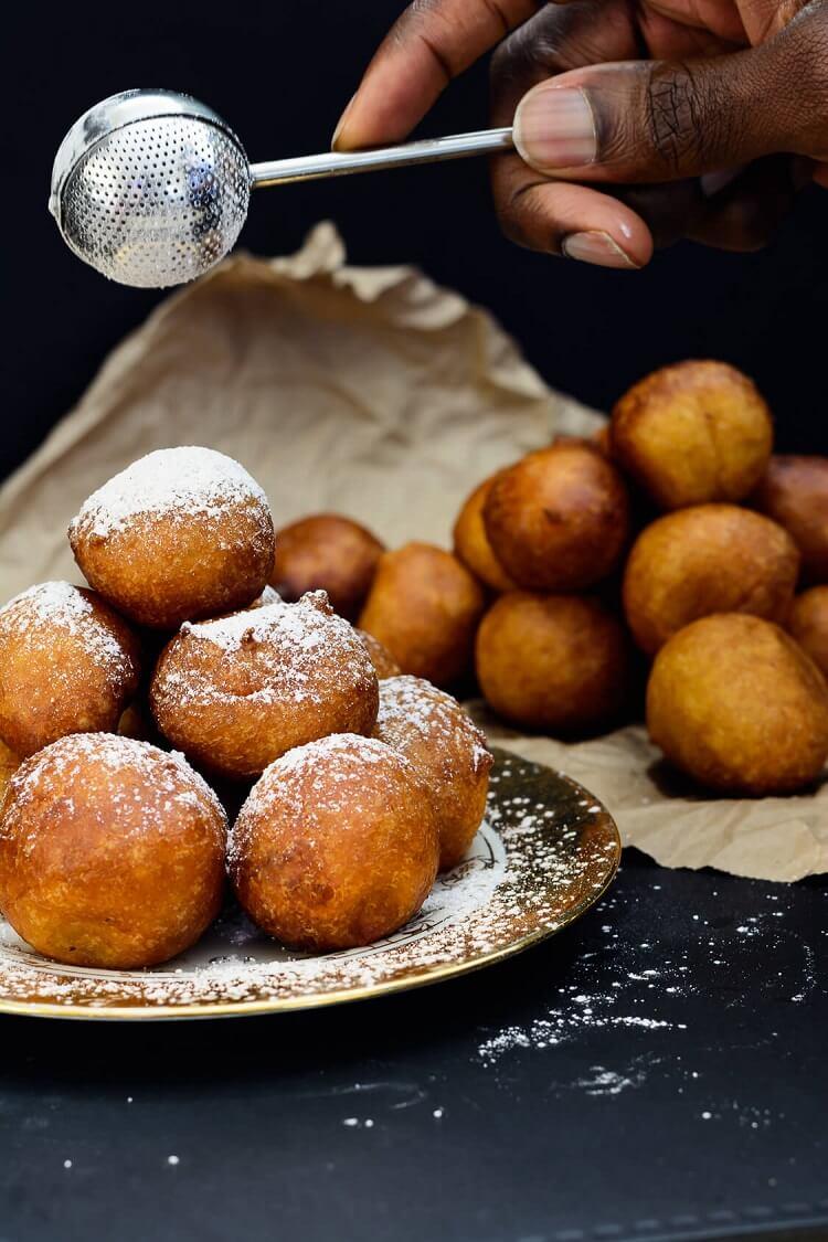 Pumpkin Drop Donuts (Nigerian Pumpkin Puff Puff) - hand sprinkling pumpkin spice sugar