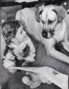 Girl Storytelling to Dog