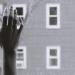 Hand touching window pane.
