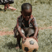 Child playing with a soccer ball.