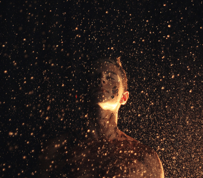 Man's face and a starry sky