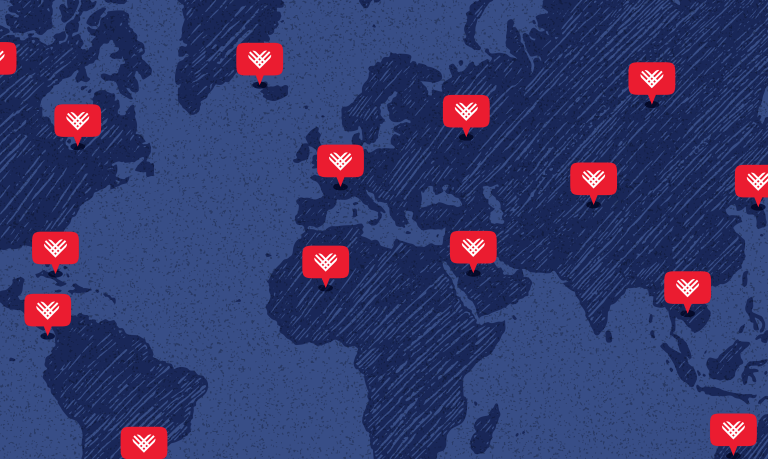 blue map of continents with red heart bubbles scattered throughout