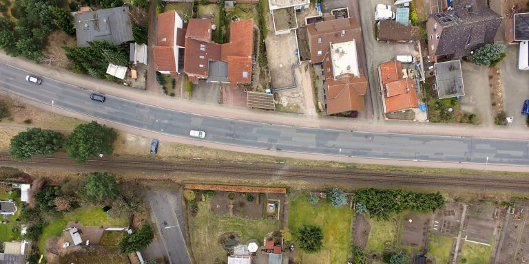 Aerial view of an old housing estate on the outskirts of the city with railway tracks close to the buildings