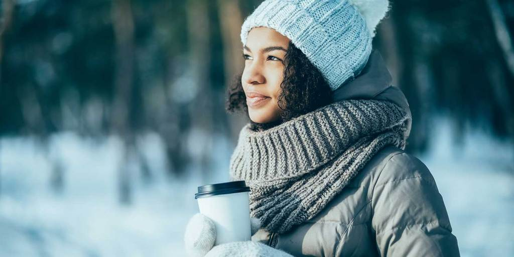 African American young woman enjoying sunny winter day alone