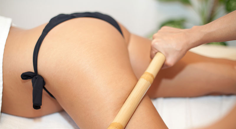 masaj anticelulitic cu bete de bambus