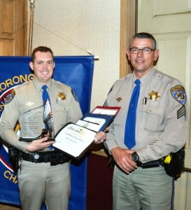 CHP Officer Simon Miller receives his Footprint Award from CHP Sgt. Green.