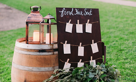 Wine barrel with lanterns and seating chart
