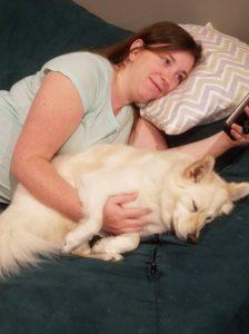 Mom holding dog baby